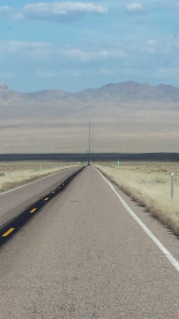 long road ahead. a cloud cuts through the view